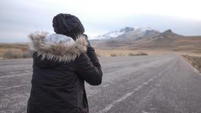 Ein Bild des Fotografen Foto des Berges machend Lizenzfreies Stockbild