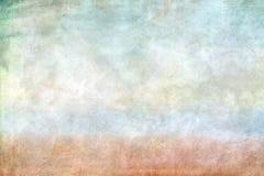 Ein Blatt Papier mit undeutlichem Aquarell malt, auf grünliche Töne, ein Blaues und brauner Streifen erscheint zur Unterseite, ei Stockbild