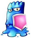 Ein blaues Monster, das ein rosa Schild hält Stockfoto