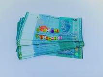 Ein Block von BuchstabeReisekosten mit einer Währung mit einem weißen Hintergrund lizenzfreie stockfotos