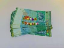 Ein Block von BuchstabeReisekosten mit einer Währung mit einem weißen Hintergrund stockbild