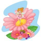Ein Blumenelf über einer großen rosa Blume Stockbilder