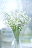 Ein Blumenstrauß der Lilien des Tales Stockbild