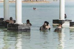 EIN BOKEK, ISRAEL 22 October 2018: People floating in Dead Sea circa stock images