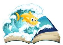 Ein Buch mit einem Bild eines Haifischs und der Welle Stockbild