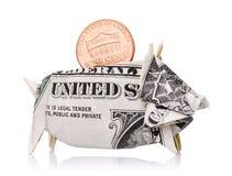 Ein Cent in einem Sparschwein eines amerikanischen Dollars lokalisiert Stockfotografie