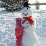 Ein Childs-Gedächtnisse von Schneemännern und von Spaß-Wintern stockfoto
