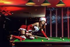 Ein chinesisches Mädchen gekleidet in den Weihnachtskostümen Stockfoto