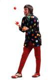 Ein Clown jongliert Kugeln Lizenzfreies Stockfoto