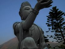 Ein des Angebots des sechs Devas nahe großem Buddha in Hong Kong jan. 2013 Lizenzfreie Stockfotos