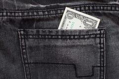 Ein Dollar lösen Jeanstasche ein Stockfotografie