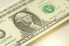Ein Dollar mit einer Anmerkung 1 Dollar Stockbild
