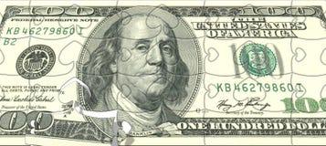 Ein Dollarpuzzlespiel Lizenzfreie Stockfotos