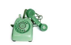 Ein Dreharttelefon der alten grünen Weinlese weg vom Haken Stockfotos