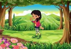Ein Dschungel mit einem modernen jungen Mädchen Lizenzfreie Stockbilder