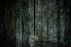 Ein dunkler grungy hölzerner Hintergrund Lizenzfreies Stockbild