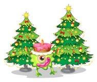 Ein einäugiges Monster, das einen Geburtstag nahe dem Weihnachten-tre feiert Stockfotos