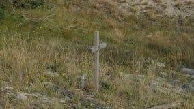 Ein einzelnes Kreuz in der Wildnis - das Symbol der Abzahlung, Lizenzfreies Stockfoto