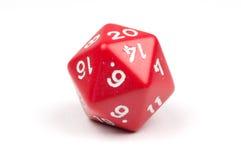 Ein einzelnes mit Seiten versehenes Rot 20 sterben auf Weiß stockbild