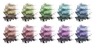 Ein enormer Satz mehrfarbiger dreifacher Lidschatten Zerquetschte Augenschminke Kosmetisches Produkt Stockbilder