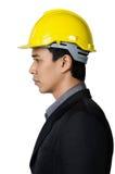 Ein ernster junger Vorarbeiter auf der Seitenansicht lokalisiert Lizenzfreies Stockbild