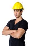 Ein ernster junger Vorarbeiter lokalisiert Stockfotos