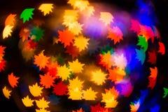 Ein festliches Kaleidoskop, ein helles Licht und greller Glanz Zusammensetzung von Stockbild