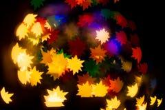 Ein festliches Kaleidoskop, ein helles Licht und greller Glanz Zusammensetzung von Lizenzfreies Stockbild