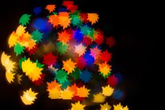 Ein festliches Kaleidoskop, ein helles Licht und greller Glanz Zusammensetzung von Stockfotos