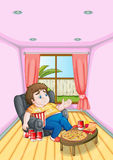 Ein fetter junger Mann vor einer Tabelle voll von Nahrungsmitteln Stockbild