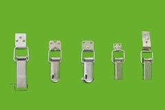 Ein Fragment von verschiedenen Arten von einfachen mechanischen Verschlussklinken Stockfotografie