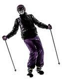 Ein Frauenskifahrer-Skifahrenschattenbild Lizenzfreies Stockbild