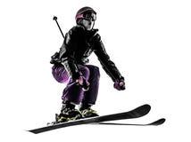Ein Frauenskifahrer-Skifahrenspringen Schattenbild Lizenzfreie Stockfotografie
