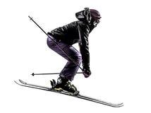 Ein Frauenskifahrer-Skifahrenspringen Schattenbild Lizenzfreie Stockfotos