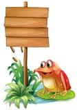 Ein Frosch über der Seerose neben dem hölzernen Schild Lizenzfreies Stockbild