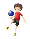 Ein Fußballspieler, der den Ball mit der australischen Flagge verwendet Lizenzfreies Stockfoto