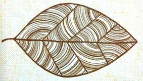 Ein gemaltes Blatt eines Baums Stockfoto