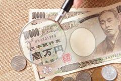 Ein genauer Blick am japanischen Geld Stockfoto