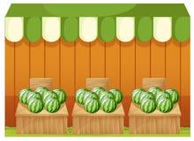 Ein Geschäft von Wassermelonen mit leeren Brettern Lizenzfreies Stockbild