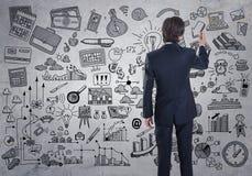 Ein Geschäftsmann, der eine Geschäftsskizze zeichnet Lizenzfreie Stockfotografie