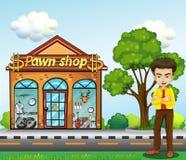 Ein Geschäftsmann, der vor dem Pfandhaus steht Stockbild
