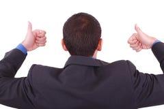 Ein Geschäftsmann gibt Daumen auf (rückseitig) Stockbild