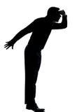 Ein Geschäftsmann-Schattenbild Tiptoe, der weg schaut lizenzfreies stockfoto