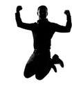Ein Geschäftsmann, der leistungsfähiges Schattenbild springt Stockfoto