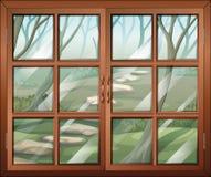 Ein geschlossenes Fenster mit Blick auf den Wald Stockfoto