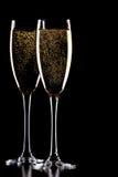 Ein Glas Champagner, getrennt auf einem Schwarzen. Stockfotos