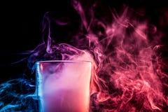 Ein Glas mit buntem Rauche Lizenzfreies Stockbild