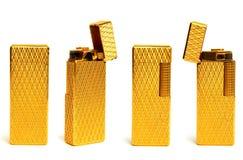 Ein goldenes Feuerzeug in vier Ansichten Lizenzfreie Stockfotos