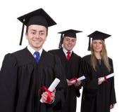 Ein graduiert, zwei andere führend, lokalisiert auf Weiß Lizenzfreie Stockbilder