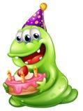 Ein greenslime Monster, das einen Geburtstag feiert Stockfotografie